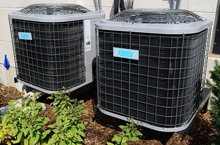 Two outdoor air conditioning units side by side