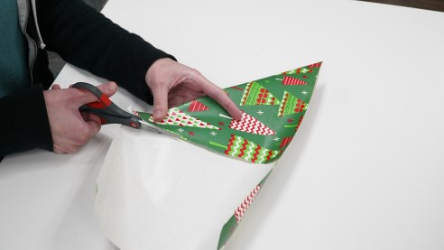 Cutting excess wrapping paper into a square