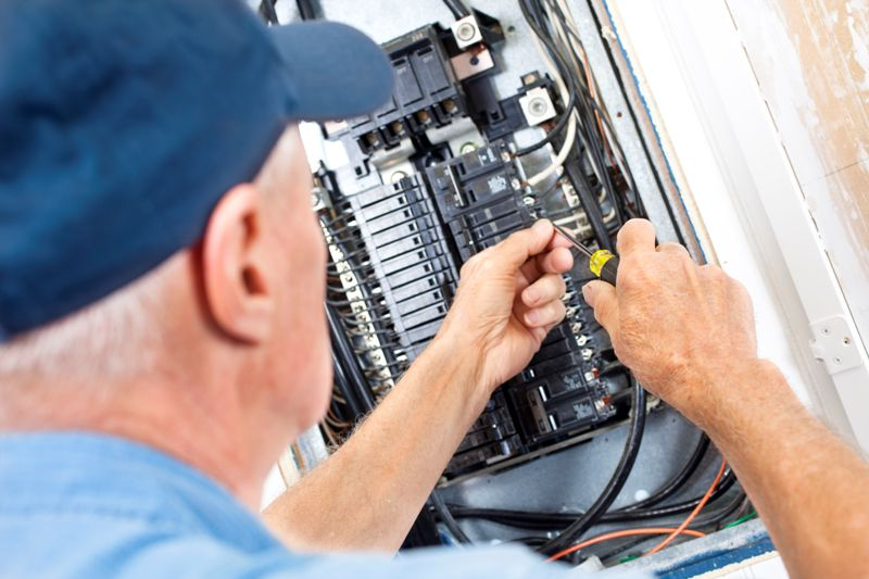 electrician fixing gfci breaker