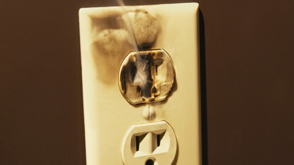 burned and damaged electrical receptacle
