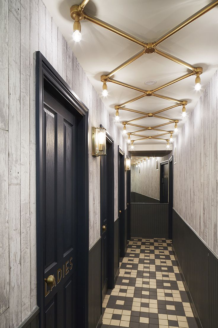 bright restaurant lighting in hallway leading to bathroom