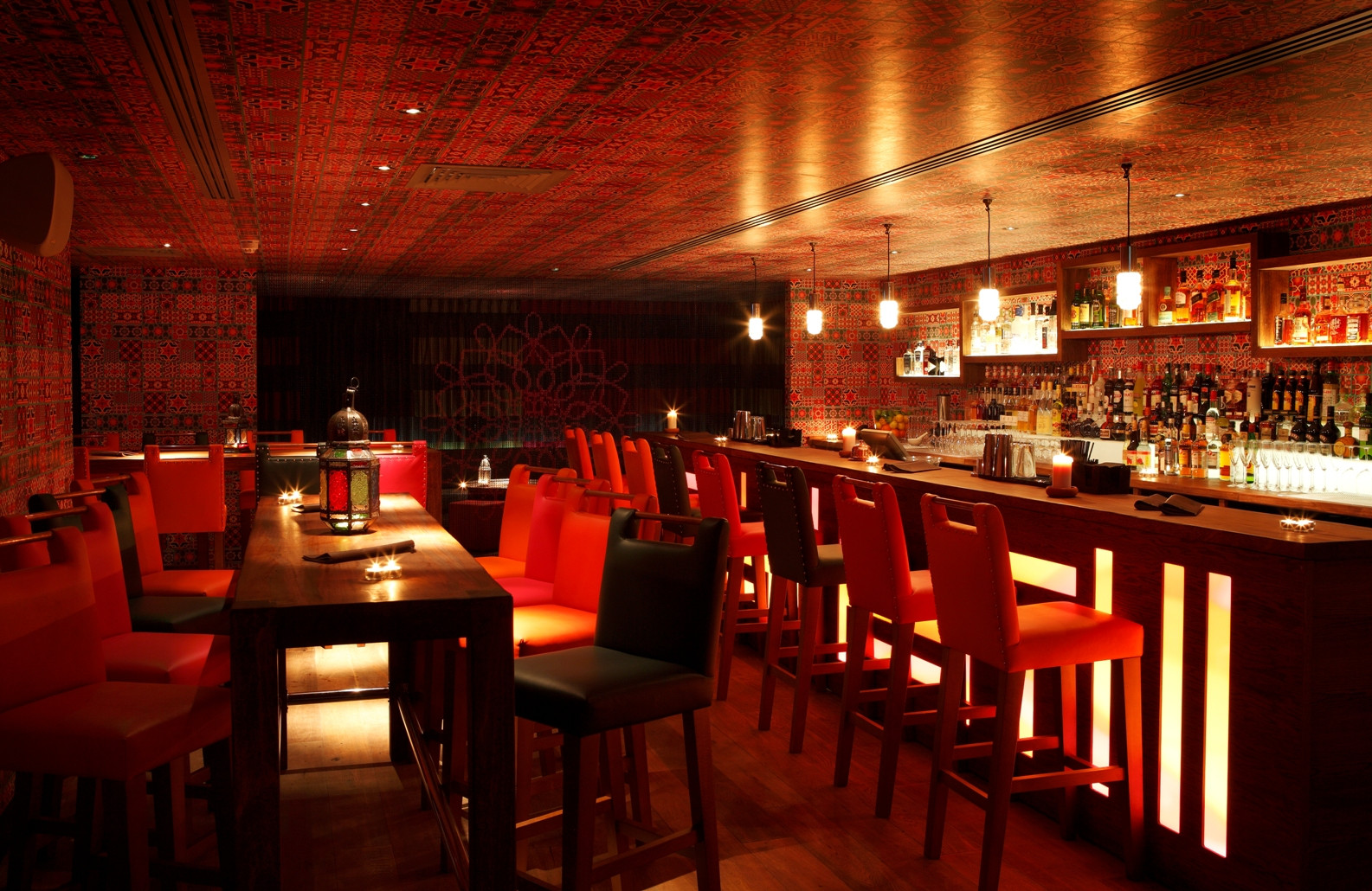 red interior walls restaurant lighting