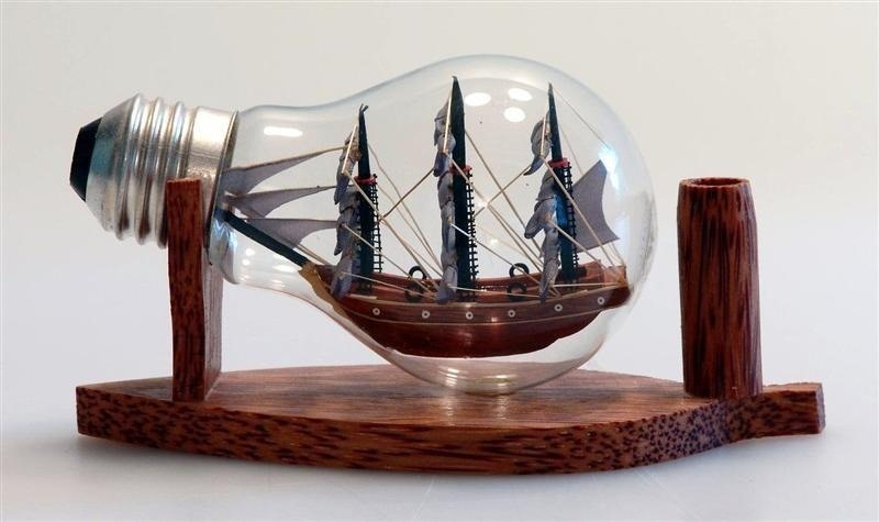 a toy ship inside of a used bulb