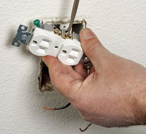 unscrew electrical outlet from wall