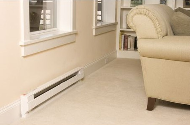 Baseboard heater behind chair