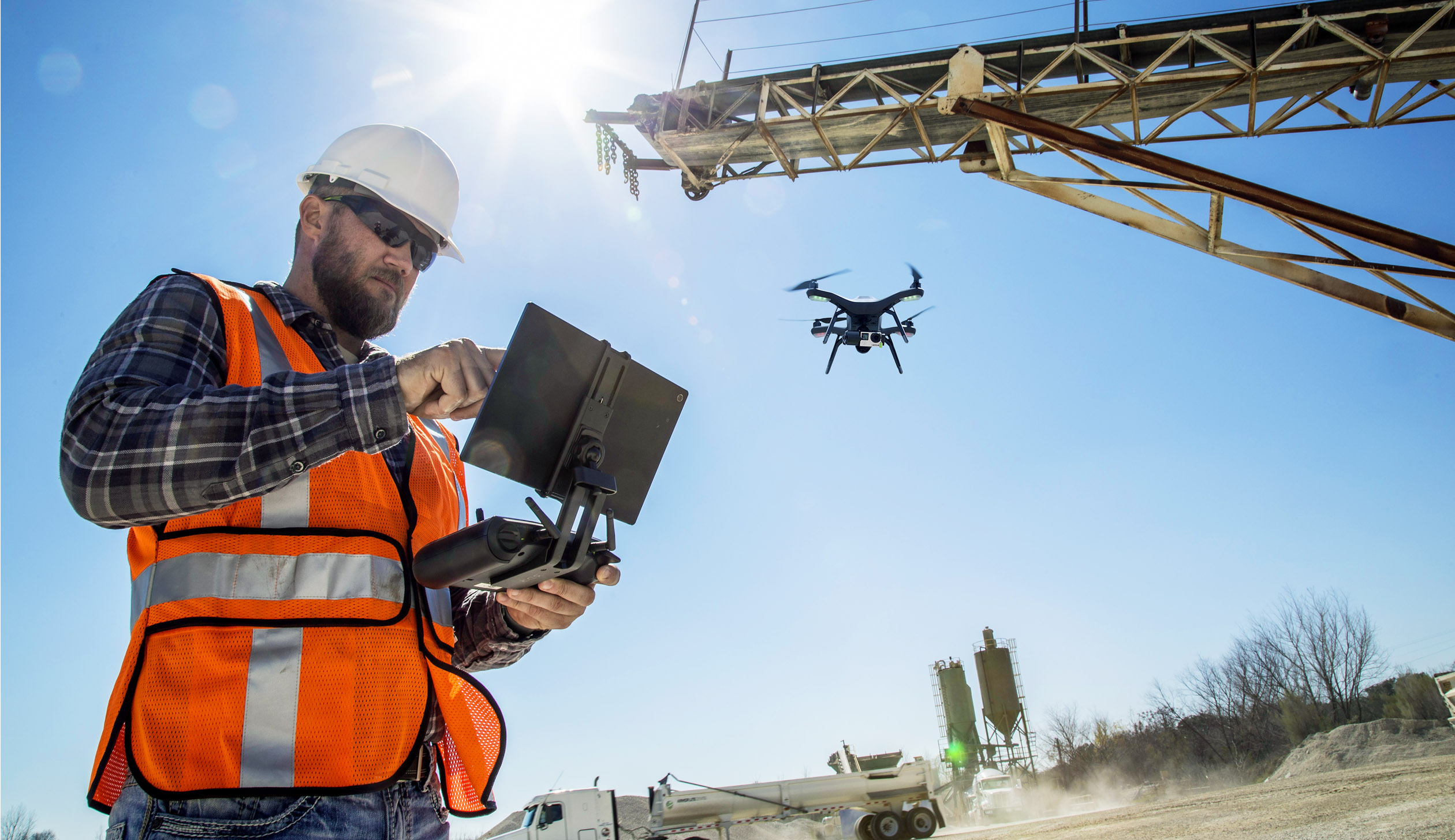 Worker with Drone on Site