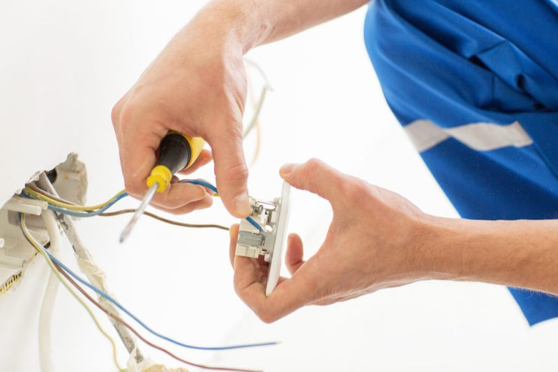 Electrician Installing GFCI Outlet