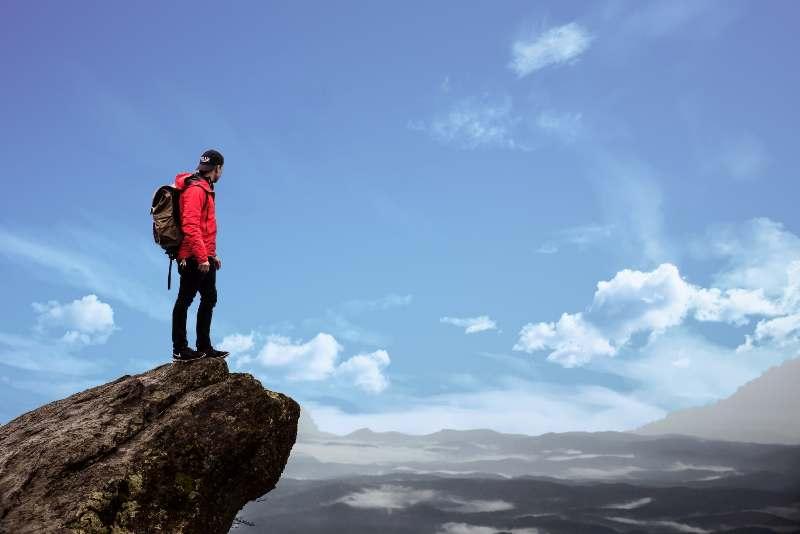Man standing on a high rock