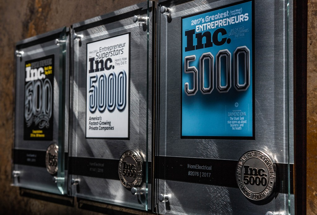 three Inc. 5000 plaques on the wall