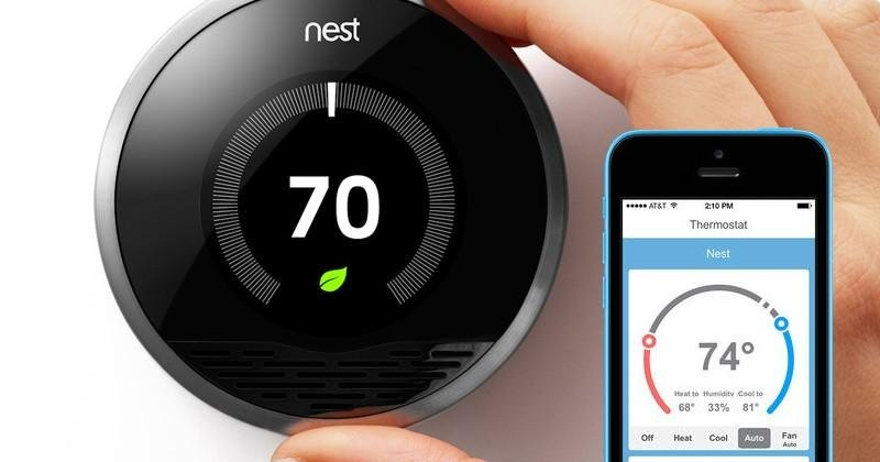 black and silver nest thermostat with smartphone showing the app