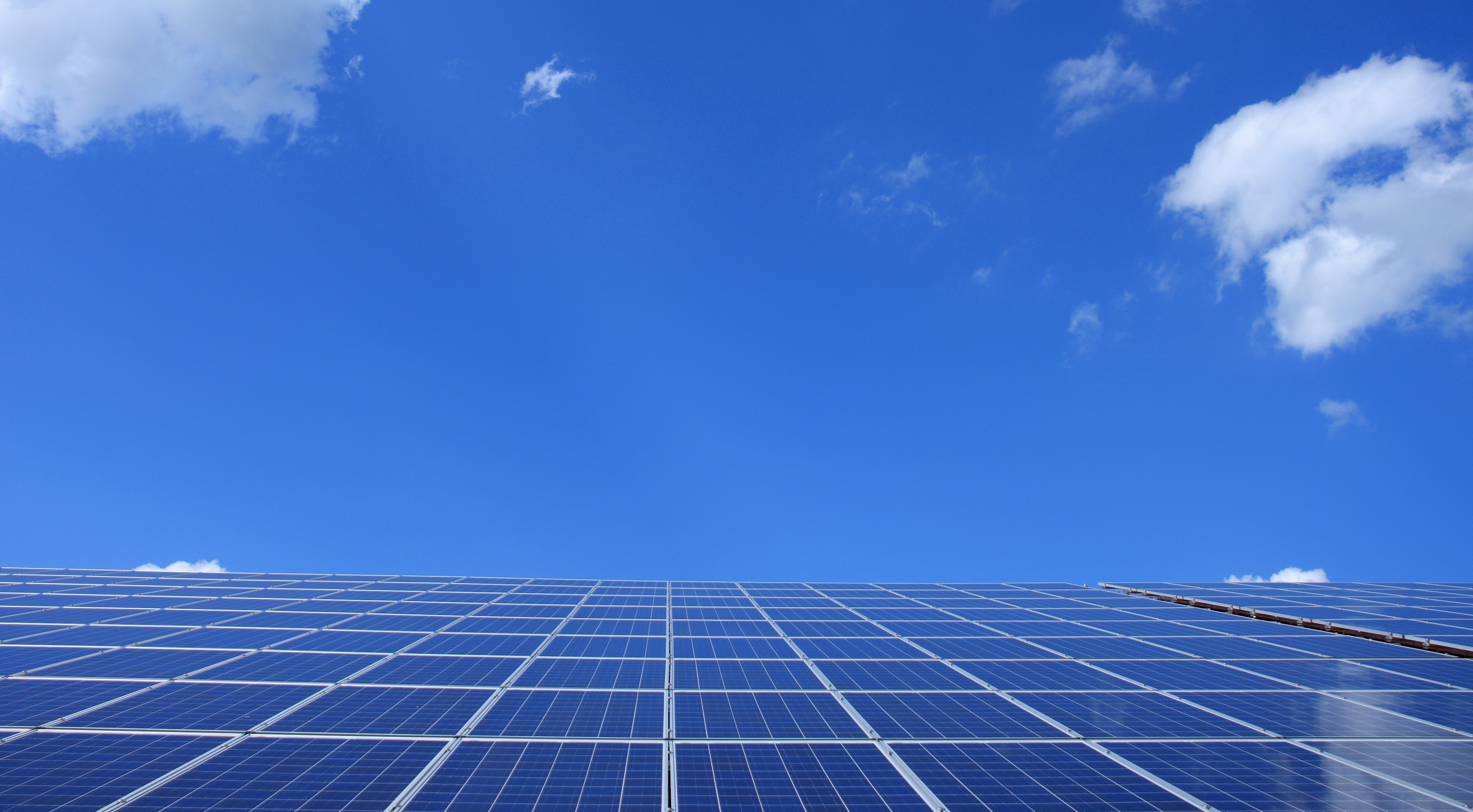 Solar panels from an angled view with a blue sky background