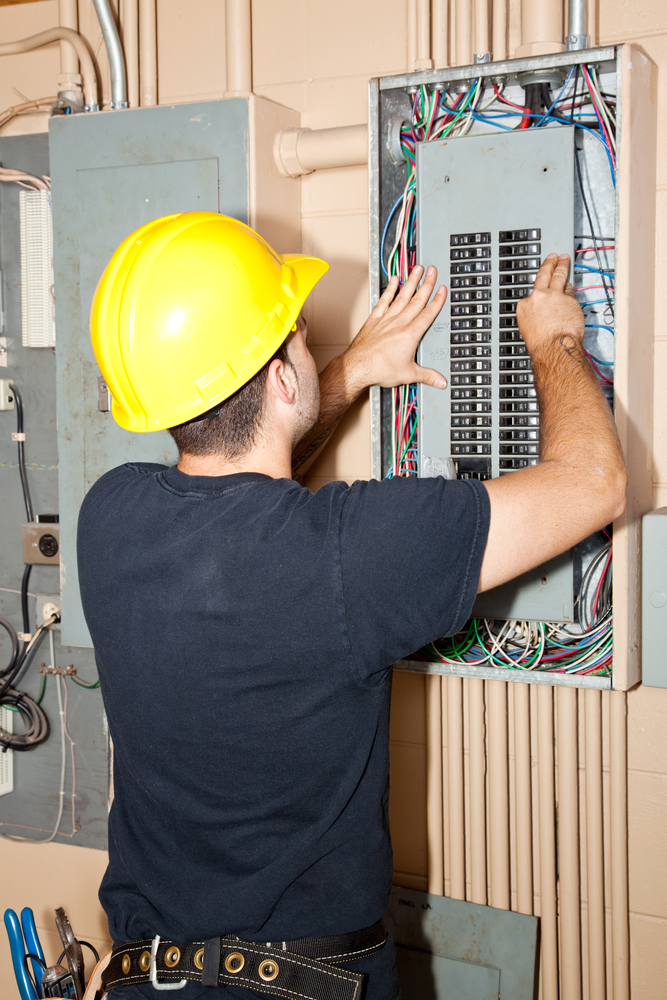 electrician fixing electrical circuit breaker box