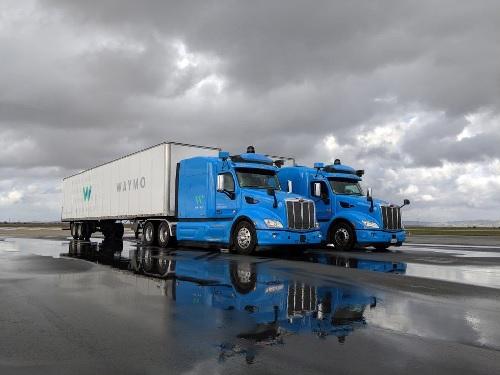 Waymo self-driving cargo trucks in parking lot